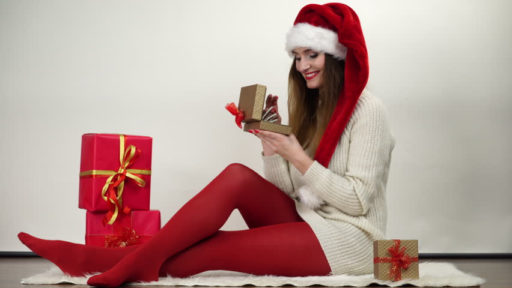 Lady holding christmas presents
